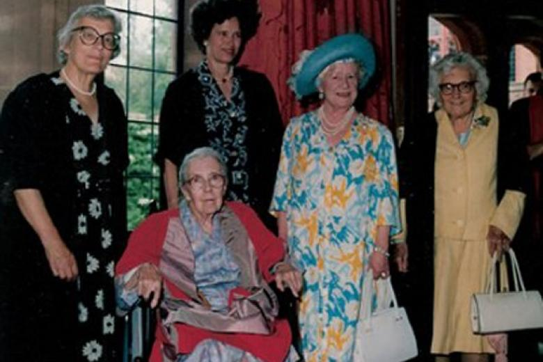 The Queen Mother (Visitor 1948-2002) with four Girton Mistresses, from left Mary Warnock, Mary Cartwright, Juliet Campbell and Muriel Bradbrook.