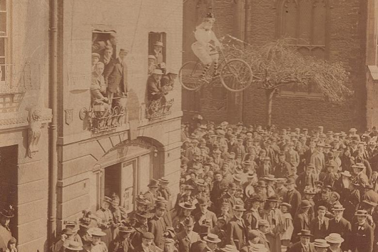 Effigy of a female student hanging from the window in the centre of Cambridge during the protests of 1897, taken by Messrs Stearn (archive reference: GCPH 9/1/4)