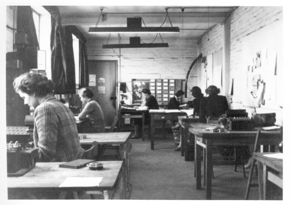 Bletchley Park personnel, at work in the Hut 6 machine room in Block D, probably early 1945 (image reproduced courtesy of Bletchley Park)