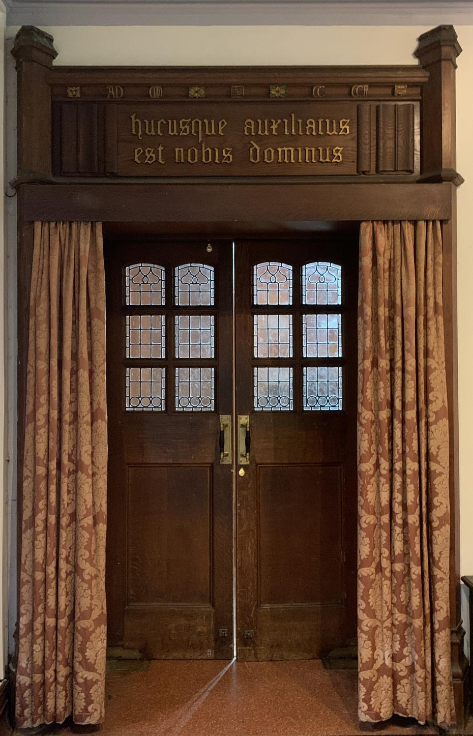 The Chapel door with the inscription above it, photographed by Hannah Sargent (Communications Officer 2013), 2020 (archive reference: GCPH 2/4/17).