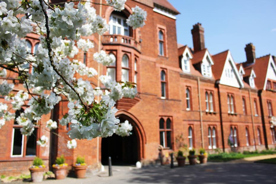 Girton College Tower and tree blossom